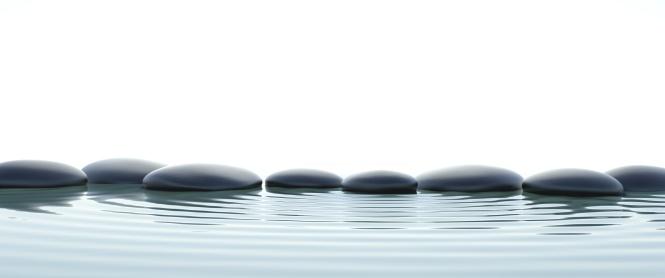Zen stones in water on widescreen